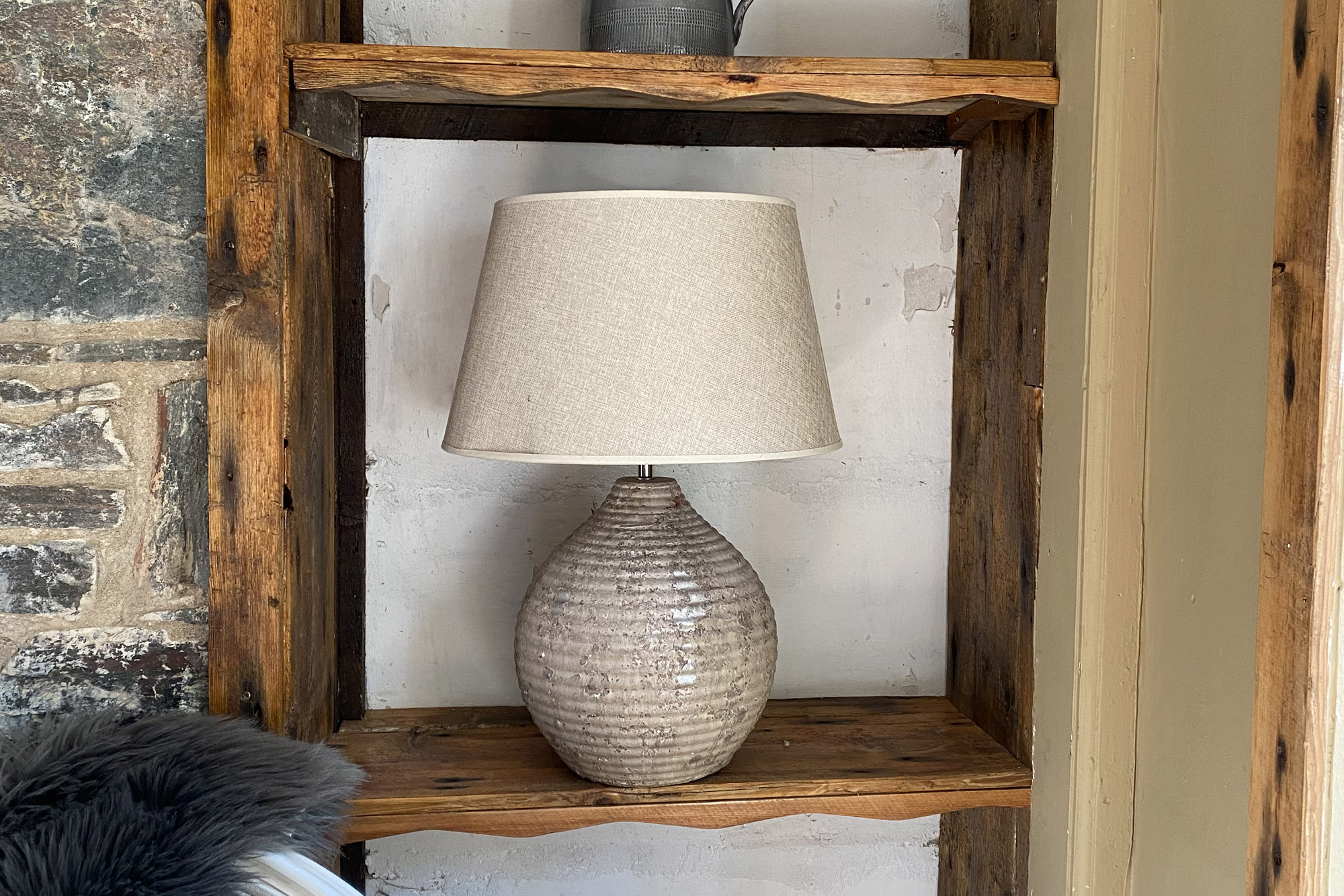 A lamp on a wooden shelf at The Dornie | Hotel in the Highlands