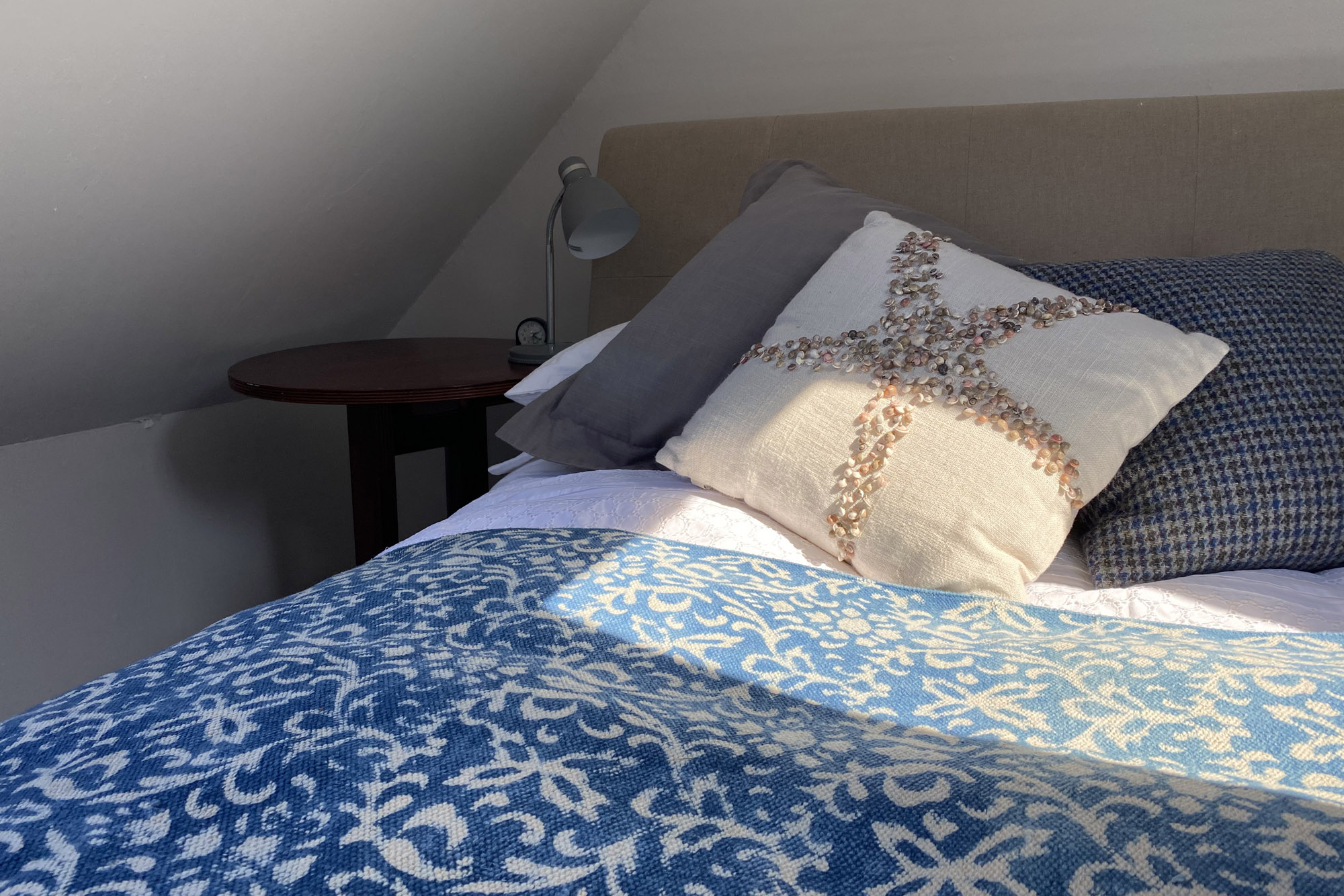 Star fish pillow on comfy bed | Hotel in the Highlands