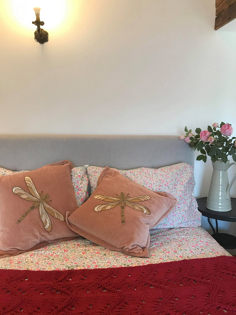 Pink flowers by the bed | Hotel in the Highlands